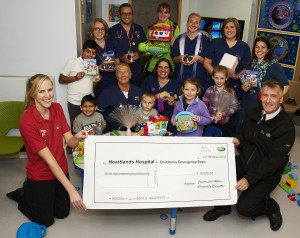 Asda & Jaguar donate money and toys to childrens ED department following floods
